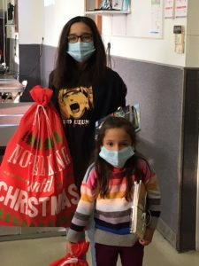 Parent and Child with Sacks from Santa
